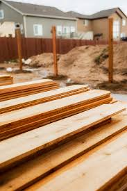 New Fence Construction Fence Posts In Background Timber In Foreground Stock Photo Download Image Now Istock