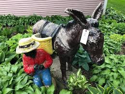 donkey and boy cement lawn ornament