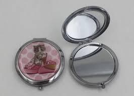 silver metal hand travel round makeup