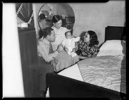 Louis Jones, Ada Harris, and Lena Horne, gathered around baby ...