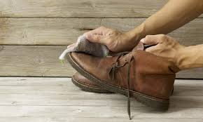 leather work boots with household items
