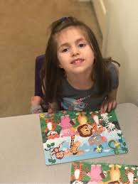 Asenath loves her new puzzle and plays... - Greenfield Central School  Foundation | Facebook