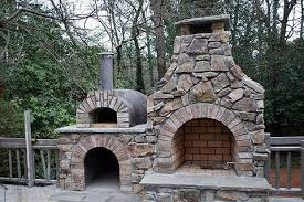 outside fireplace with pizza oven