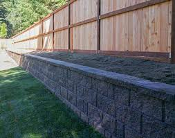 Lacey Retaining Wall And Privacy Fence Backyard Fences Backyard Retaining Walls Landscaping Retaining Walls