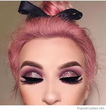 glitter eye makeup and a high hair bow on pink
