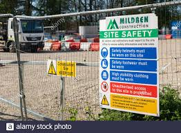 A Site Safety Board On Heras Fencing At The Entrance To A Building Site Empty With No Construction Work During The Covid 19 Pandemic April 2020 Uk Stock Photo Alamy
