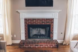 modern white brick fireplace walnut