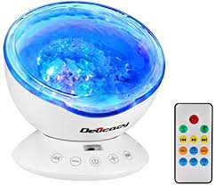 Amazon Com Delicacy Ocean Wave Projector 12 Led Remote Control Undersea Projector Lamp 7 Color Changing Music Player Night Light Projector For Kids Adults Bedroom Living Room Decoration Musical Instruments
