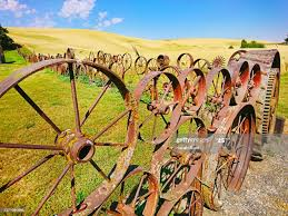 Country Welded Wagon Wheel Fence With Agricultural Wheat Farmland In The Background High Res Stock Photo Getty Images