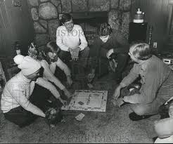 1982 Press Photo Priscilla Griffin and friends play Monopoly in living |  Historic Images