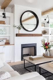 black mirror on white brick fireplace