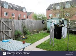 Clothes Hanging On Fence In High Resolution Stock Photography And Images Alamy