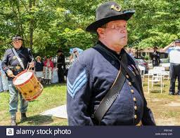 Allen H. Bright, sergeant of the color guard and a Civil War re-enactor of  the Sons of Union Veterans of the Civil War, and Greg Krohn, a Civil War  re-enactor of the