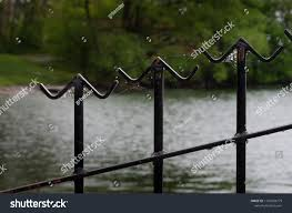 Closeup Three Metal Fence Finials Angled Stock Photo Edit Now 1101804779