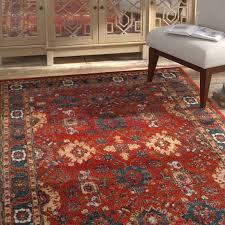 three posts sparks orange blue area rug