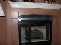 mantel above a gas fireplace