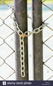 A Lock And Chain On Metal Fence That Links Of A Gate Stock Photo Alamy
