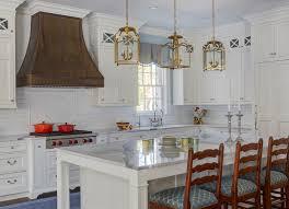 brass pendant lights over large kitchen