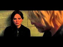 Image result for haymitch reads to Katniss