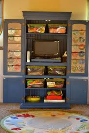 Tv Cabinet Inspiration From Infarrantly Creative Blog This Will Be Great In The New Playroom Playroom Organization Game Storage Organization Kids