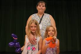 PHOTOS: Bay Lake Elementary School Grandparents' Night - Isabella, left,  and Aby Whittington posed with their balloon animals for a photo with their  nana Ursula. | West Orange Times & Windermere Observer