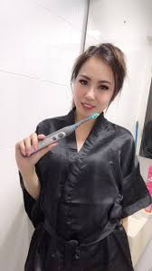cariPRO Ultrasonic Electric Toothbrush - Adeline Miller
