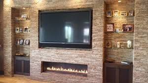 hang the tv over the fireplace
