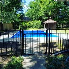 Some Black Aluminum Fencing And Some Wood Fencing Around A Pool In A Beautiful Area Blackmetalfence Pool Fence Fen In 2020 Aluminum Fencing Wood Fence Metal Fence