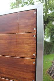 wooden gates with stainless steel frame