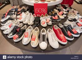 A display of shoes on sale at GEOX SHOES on West 34th Str. in the Herald  Square section of Manhattan, New York City Stock Photo - Alamy
