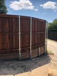 Pre Sealed Cedar Board On Board Fence With Trim Cap Treated Retaining Wall And Metal Posts Installed By Titan Fenc Cedar Boards Fence Design Retaining Wall