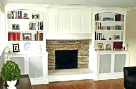 fireplace with shelves on each side