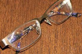 how to remove scratches from glasses in
