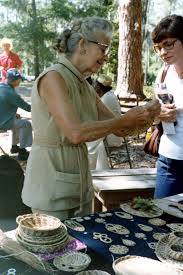 Florida Memory • Iva Campbell, of Miami, showing her pine needle crafts-  White Springs, Florida