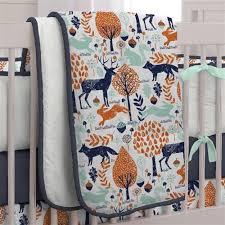 navy and orange woodland crib bedding