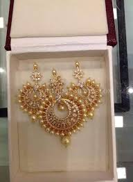 gold pearl pendant and earrings design