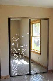 Idea Updating Mirrored Closet Doors With Decals Mirror Closet Doors Closet Door Makeover Glass Closet Doors