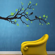 Black Tree Branch Wall Decal With Green Vinyl Leaves And Black Bird Wall Stickers All Placed On A Blue Wall Behin Vinyl Wall Stickers Wall Sticker Yellow Chair