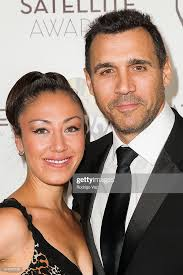 Designer Alexandra Tonelli and actor Adrian Paul arrive at the ...