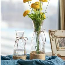 clear glass flower vase with rope