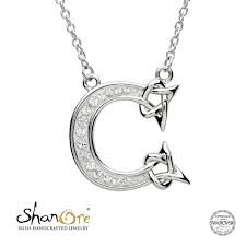 c adorned with white swarovski crystal