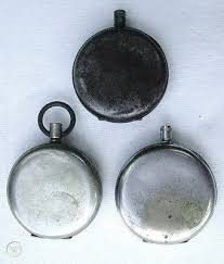 three empty pocket watch cases for