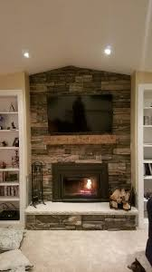 stone fireplace finished with a mantel