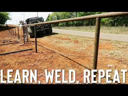 Setting Posts For Fence Saddling And Welding Out Top Rail Pipe Fence Youtube
