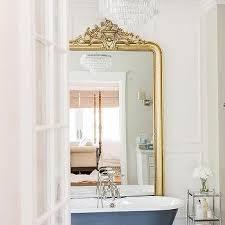 french rococo mirror behind bathtub