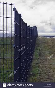Safety Fence On The Green Meadow Stock Photo Alamy