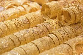 gold jewellery on in window