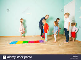 Kids Barefoot Stand In A Row Between Massage Tactile Plastic Mats Stock Photo Alamy