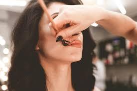 professional visagiste does makeup to a