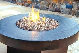 propane fire pit with glass hide away